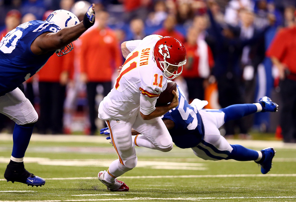 . INDIANAPOLIS, IN - JANUARY 04:  Quarterback Alex Smith #11 of the Kansas City Chiefs runs with the ball against the Indianapolis Colts during a Wild Card Playoff game at Lucas Oil Stadium on January 4, 2014 in Indianapolis, Indiana.  (Photo by Andy Lyons/Getty Images)