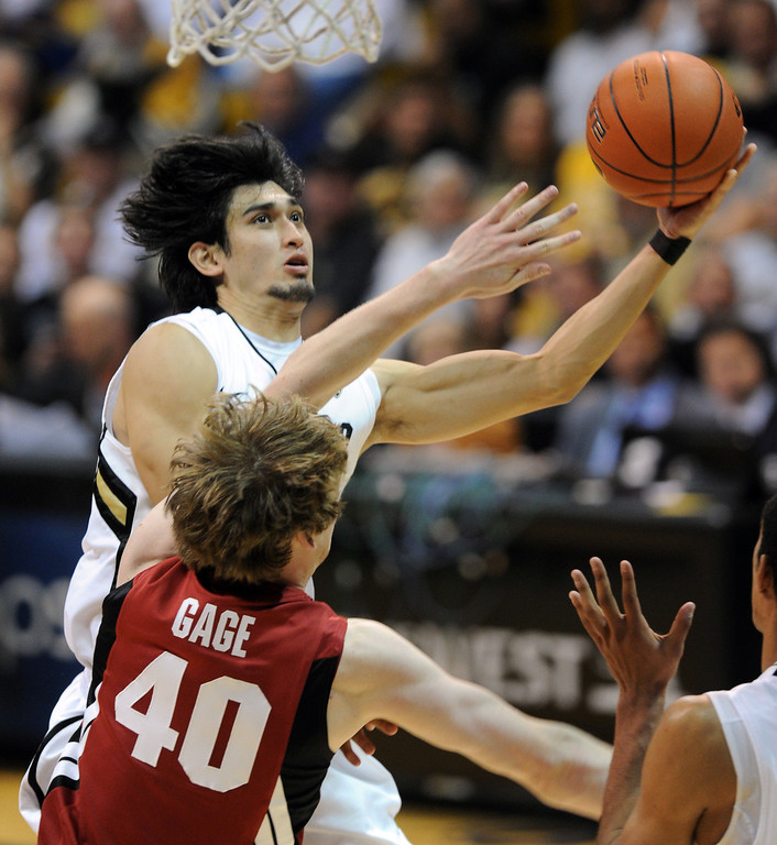 . Sabatino Chen of Colorado goes to the basket on John Gage of Stanford during the second half of the January 24th, 2013 game in Boulder. For more photos of the game, go to www.dailycamera.com. Cliff Grassmick / January 24, 2013