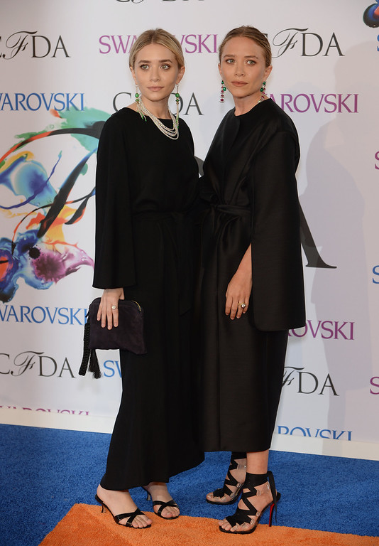 . Designers Ashley Olsen (L) and Mary-Kate Olsen attend the 2014 CFDA fashion awards at Alice Tully Hall, Lincoln Center on June 2, 2014 in New York City.  (Photo by Dimitrios Kambouris/Getty Images)