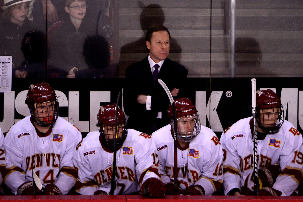 . DENVER, CO - MARCH 17: DU Head Coach George Gwozdecky of the University of Denver Pioneers watches his team take on the Colorado College Tigers during the first period of action. The University of Denver and Colorado College face off in the WCHA playoffs at Magness Arena. (Photo by AAron Ontiveroz/The Denver Post)