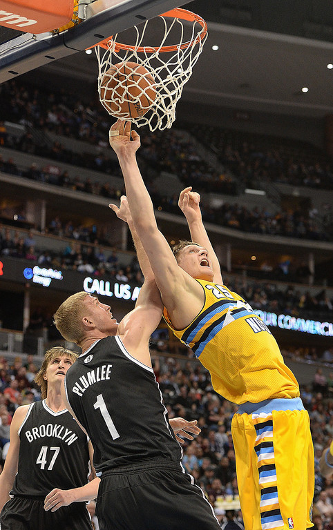 . DENVER, CO. - FEBRUARY 27, 2014: Denver center Timofey Mozgov (25) worked against Brooklyn defender Mason Plumlee (1) The Denver Nuggets hosted the Brooklyn Nets at the Pepsi Center Thursday night, February 27, 2014. Photo By Karl Gehring/The Denver Post