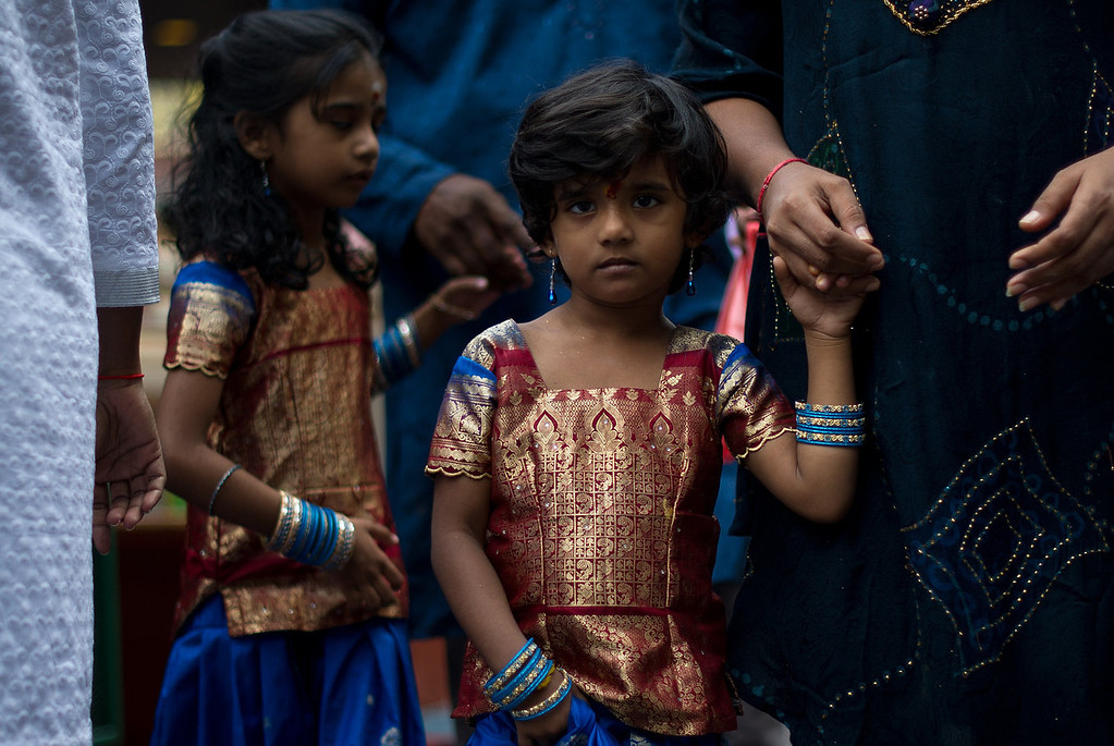 . Malaysian Hindu girls with traditional dress walk during the Diwali celebrations at a temple in the capital Kuala Lumpur on November 2, 2013. The Hindu festival of light, Diwali marks the homecoming of the God Lord Ram after vanquishing the demon king Ravana and symbolises taking people from darkness to light and the victory of good over evil. MOHD RASFAN/AFP/Getty Images