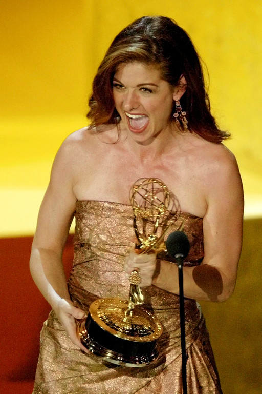 . Debra Messing accepts the award for outstanding lead actress in a comedy series for her work on �Will & Grace� at the 55th Annual Primetime Emmy Awards Sunday, Sept. 21, 2003, at the Shrine Auditorium in Los Angeles. (AP Photo/Kevork Djansezian)
