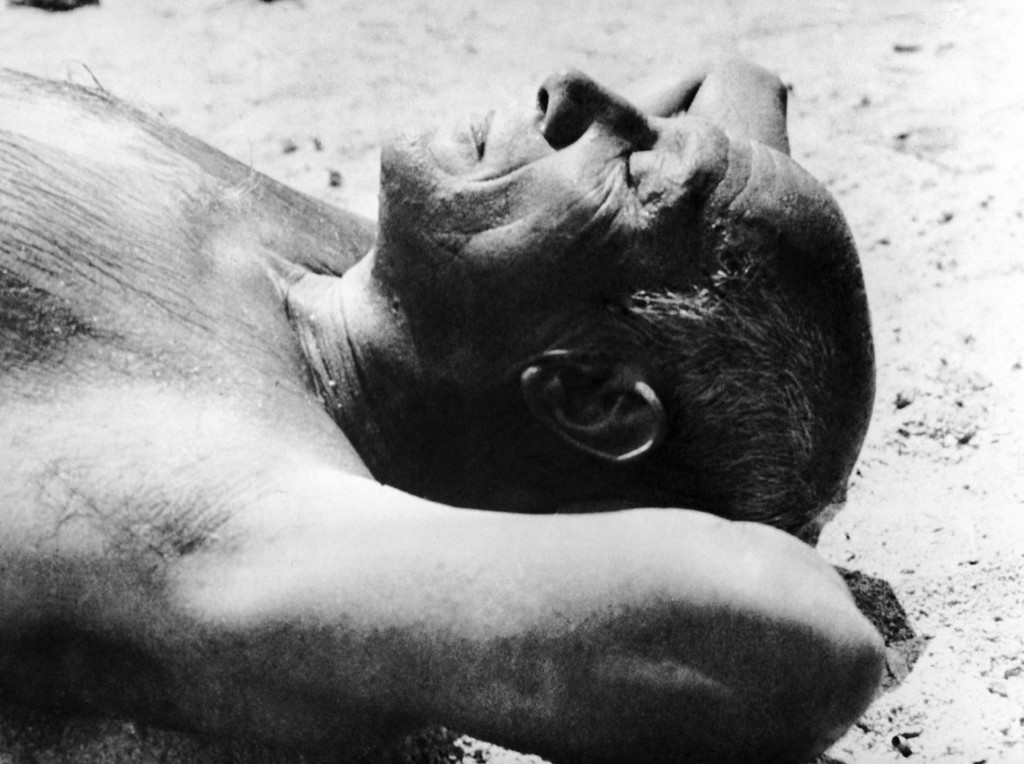 . Pablo Picasso, famed 66-year-old Spanish artist who has lived most of his life in France, suns himself on the beach at Golfe Juan in Vallauris on the French Riviera on March 10, 1948. (AP Photo)