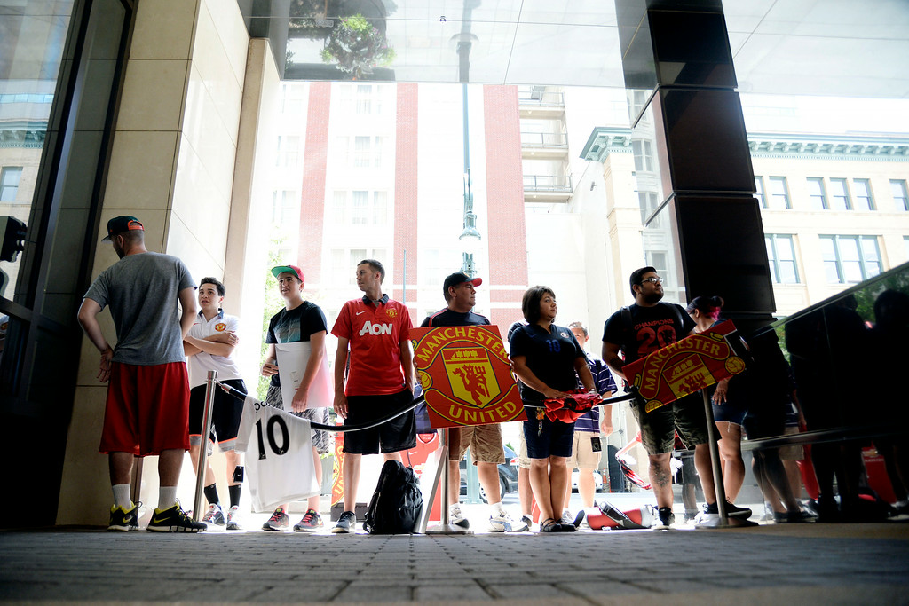 . DENVER, CO - JULY 24: Fans of the English soccer club Manchester United wait for the team bus to arrive at their hotel. Manchester United will play Italian squad Roma on Saturday, July 26 and arrived in Denver on Thursday, July 24, 2014. (Photo by AAron Ontiveroz/The Denver Post)