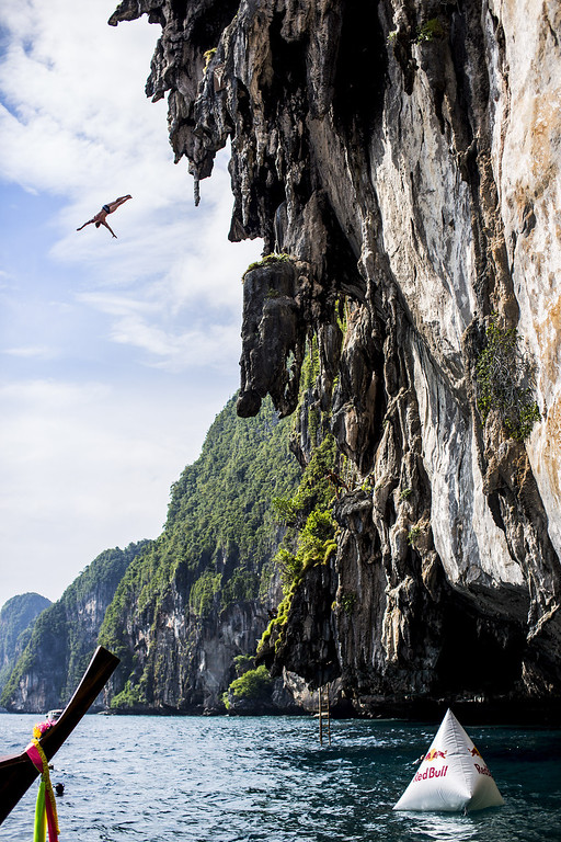 . In this handout image provided by Red Bull, Alain Kohl of Luxembourg dives from a 25 meter rock at Viking Caves in the Andaman Sea during competition on the fifth day of the final stop of the 2013 Red Bull Cliff Diving World Series on October 24, 2013 at Phi Phi Island, Thailand. (Photo by Dean Treml/Red Bull via Getty Images)
