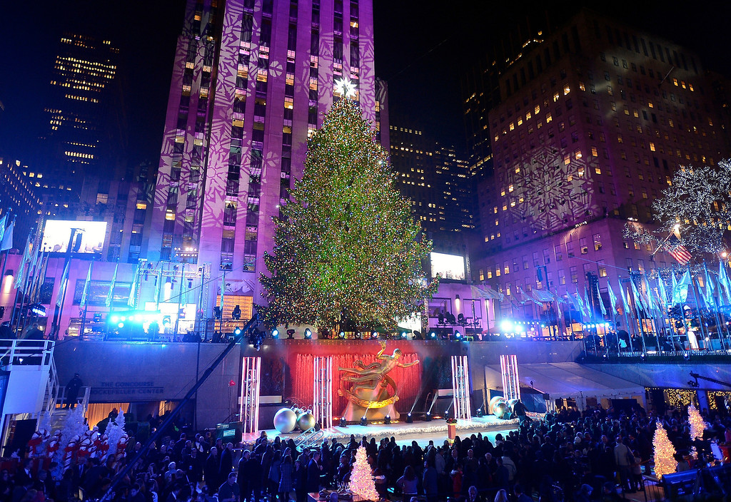 . The Rockefeller Center Christmas tree is lit during a ceremony on Wednesday, Dec. 4, 2013 in New York. Some 45,000 energy efficient LED lights adorn the 76-foot tree. (Photo by Evan Agostini/Invision/AP)