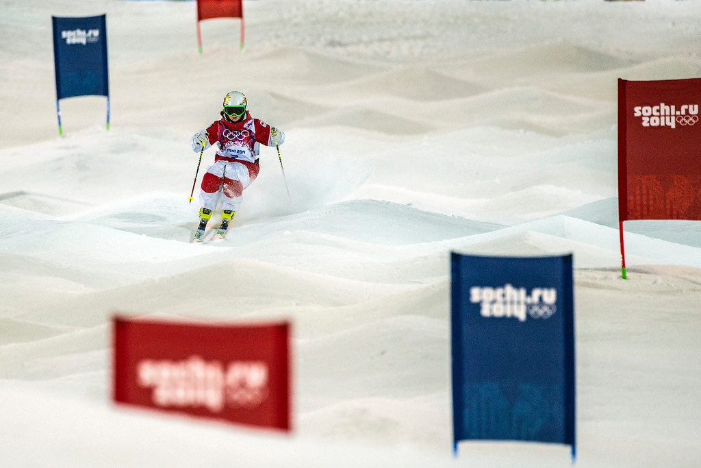 . KRASNAYA POLYANA, RUSSIA  - JANUARY 8: Chloe Dufour-Lapointe, of Canada, competes in the Ladies\' Moguls Finals at Rosa Khutor Extreme Park during the 2014 Sochi Olympic Games Saturday February 8, 2014. Justine Dufour-Lapointe won gold with a score of 22.44. Her sister Chloe Dufour-Lapointe won the silver with a score of 21.66. Hannah Kearney, of USA, won bronze with a score of 21.49. (Photo by Chris Detrick/The Salt Lake Tribune)
