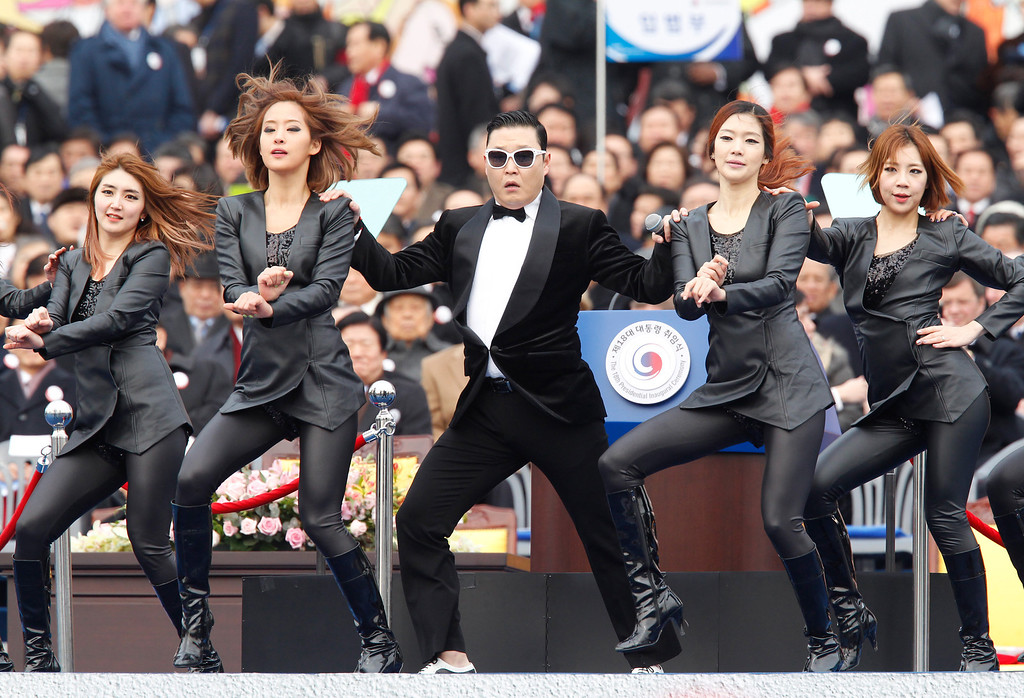 ". Singer Psy (C) performs during the inauguration ceremony of South Korea\'s new President Park Geun-Hye at parliament in Seoul on February 25, 2013. Park Geun-Hye became South Korea\'s first female president on February 25, vowing zero tolerance with North Korean provocation and demanding Pyongyang ""abandon its nuclear ambitions\"" immediately.   AFP PHOTO / POOL / Kim Hong-JiKim Hong-Ji/AFP/Getty Images"