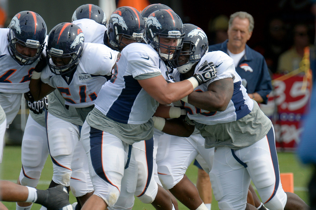 . Denver Broncos offensive line gets in some work in drills during training camp August 1, 2013 at Dove Valley. (Photo By John Leyba/The Denver Post)