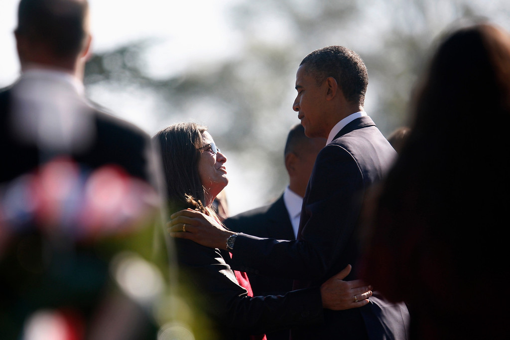 . U.S. President Barack Obama (R) greets a grieving family member in Section 60, an area where members of the U.S. military who were killed in action in Iraq and Afghanistan are buried, during Veterans Day observances at Arlington National Cemetery in Arlington, Virginia, November 11, 2012. REUTERS/Jonathan Ernst
