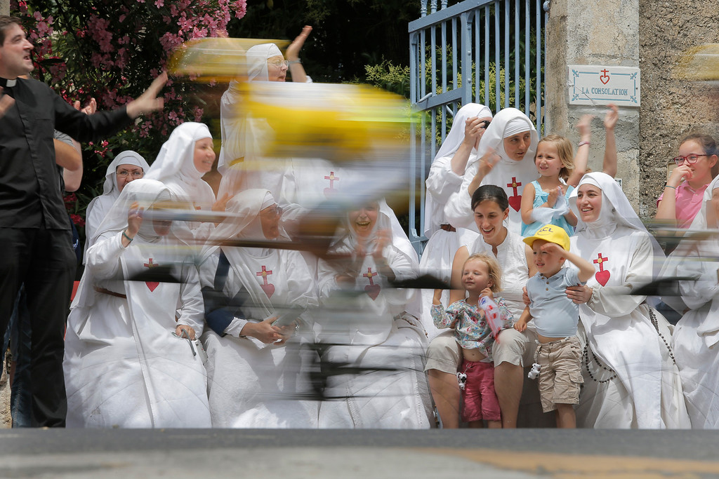 . Nuns of the Monastere de la Consolation in Draguignan cheer as Simon Gerrans of Australia, wearing the overall leader\'s yellow jersey, passes during the fifth stage of the Tour de France cycling race over 228.5 kilometers (142.8 miles) with start in Cagnes-sur-Mer and finish in Marseille, southern France, Wednesday July 3, 2013. (AP Photo/Laurent Ciprani, File)