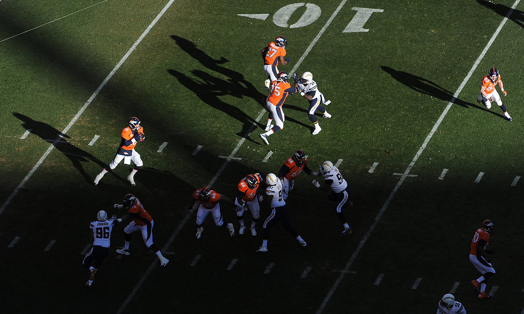 . Denver Broncos quarterback Peyton Manning (18) drops back to pass during the Broncos first series in the first quarter. The Denver Broncos take on the San Diego Chargers at Sports Authority Field at Mile High in Denver on January 12, 2014. (Photo by Craig F. Walker/The Denver Post)