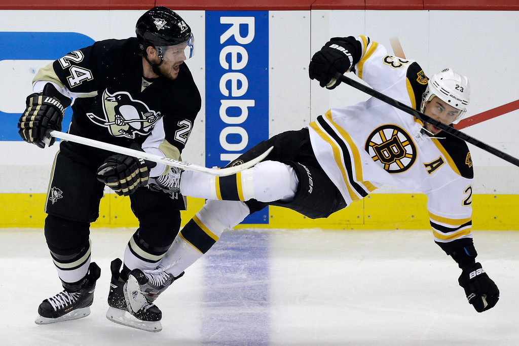 . Pittsburgh Penguins\' Matt Cooke (24) collides with Boston Bruins\' Chris Kelly (23) in the first period of Game 2 of the NHL hockey Stanley Cup Eastern Conference finals in Pittsburgh Monday, June 3, 2013. (AP Photo/Gene J. Puskar)