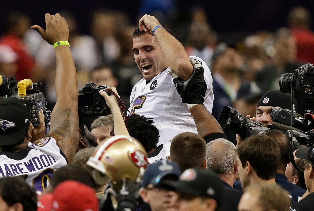 . Baltimore Ravens quarterback Joe Flacco (5) is lifted into the air by teammates after defeating the San Francisco 49ers 34-31 in the NFL Super Bowl XLVII football game, Sunday, Feb. 3, 2013, in New Orleans. (AP Photo/Bill Haber)