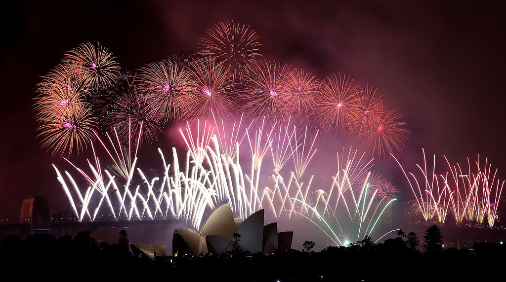 . Fireworks explode over the Harbour Bridge and the Opera House during New Year\'s Eve celebrations in Sydney, Australia, Wednesday, Jan. 1, 2014. (AP Photo/Rob Griffith)