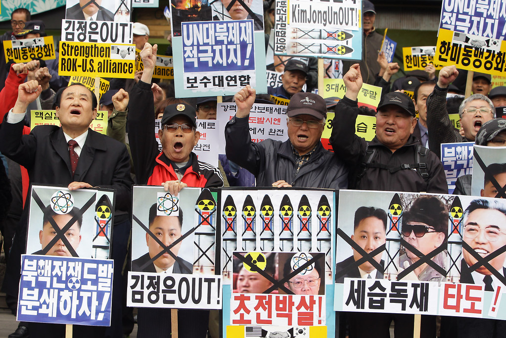. SEOUL, SOUTH KOREA - APRIL 15:  South Korean conservative protesters chant slogans during a rally demonstrating against North Korea on April 15, 2013 in Seoul, South Korea. North Korea marks its founder Kim Il-Sung\'s 101th birthday today while the fear on possible missile launch continues.  (Photo by Chung Sung-Jun/Getty Images)