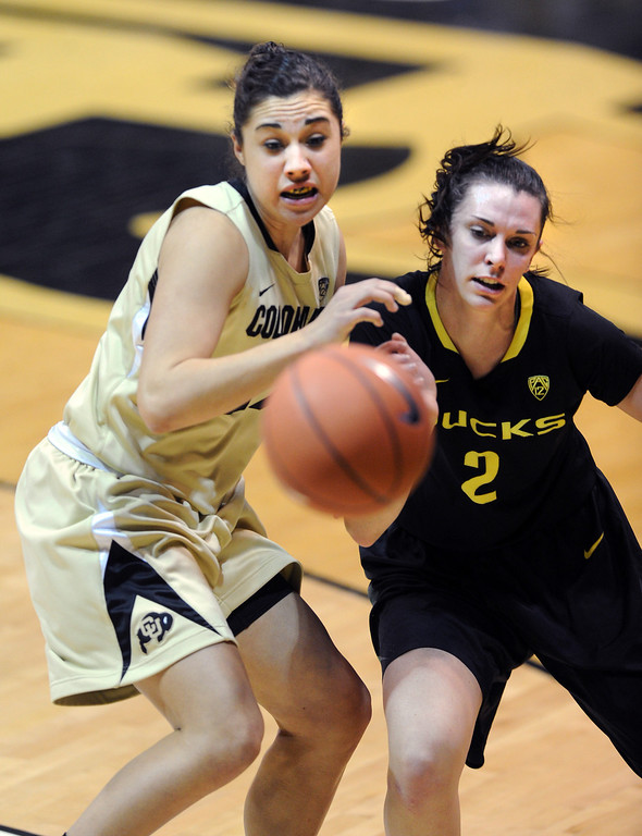 . Jasmine Sborov, left, of CU, and Danielle Love of Oregon, watch a ball go out of bounds. Cliff Grassmick / February 10, 2013