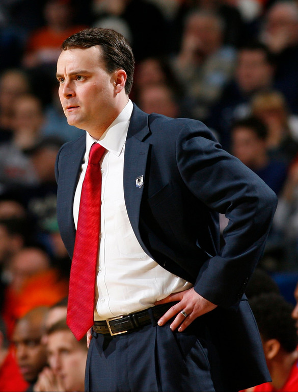 . Dayton coach Archie Miller reacts during the first half of a third-round game against Syracuse in the NCAA men\'s college basketball tournament in Buffalo, N.Y., Saturday, March 22, 2014. (AP Photo/Bill Wippert)