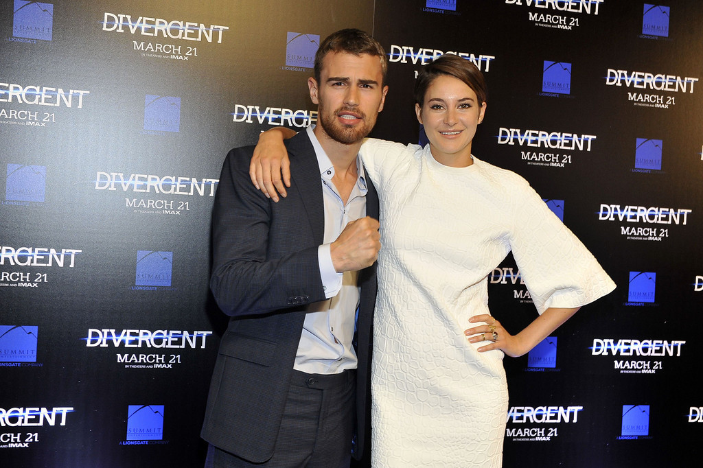 ". (L-R) Shailene Woodley and actor Theo James attend the ""Divergent\"" screening at Regal Atlantic Station on March 3, 2014 in Atlanta, Georgia. (Photo by Moses Robinson/Getty Images)"