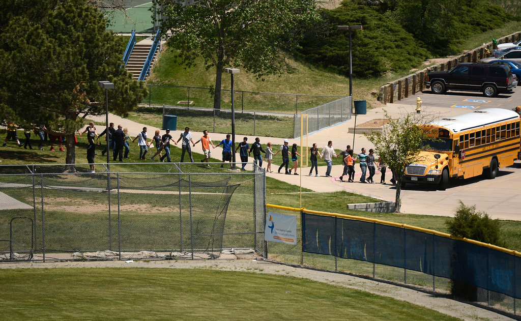 . Thornton High School was on a lock down at Police looked for a gun in the school, May 24, 2013. Some students were evacuated from the school by bus. (Photo By RJ Sangosti/The Denver Post)