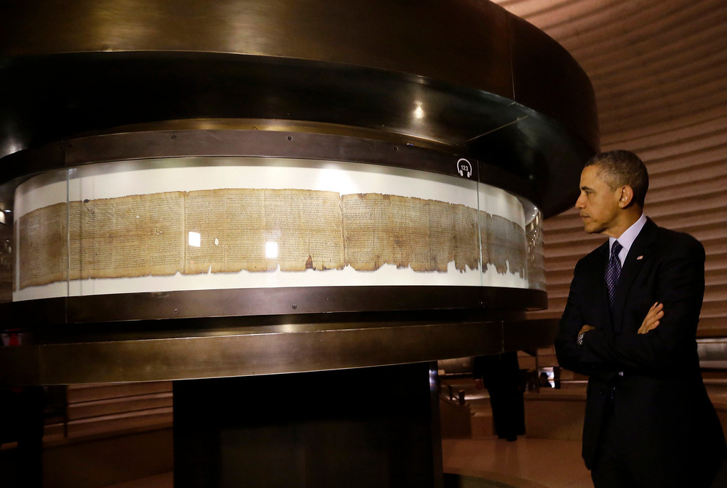 . US President Barack Obama views the Dead Sea Scrolls with Israeli Prime Minister Benjamin Netanyahu, not pictured, at the Israel Museum in Jerusalem, Israel, Thursday, March 21, 2013.  After a visit to Israel\'s national museum to inspect the Dead Sea Scrolls, which highlight the Jewish people\'s ancient connection to the land that is now Israel, Obama headed to the West Bank to tell the Palestinians that the creation of a Palestinian state remains a priority for his administration. (AP Photo/Pablo Martinez Monsivais)