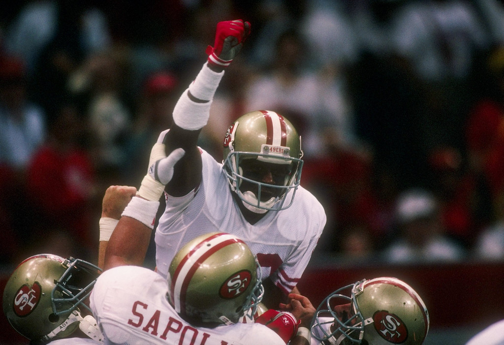 . 28 Jan 1990:  Wide receiver Jerry Rice of the San Francisco 49ers celebrates with his teammates during Super Bowl XXIV against the Denver Broncos at the Superdome in New Orleans, Louisiana.
