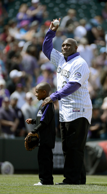 . DENVER, CO. - APRIL 21: Colorado Rockies retired player Eric Young stands with his son Dallas Young 6-years-old as he acknowledges the crowd during Erick Young bobble head day. Dallas Young threw out the first pitch to his older brother Eric Young Jr. prior to their game against the Arizona DiamondBacks April 21, 2013 at Coors Field. (Photo By John Leyba/The Denver Post)