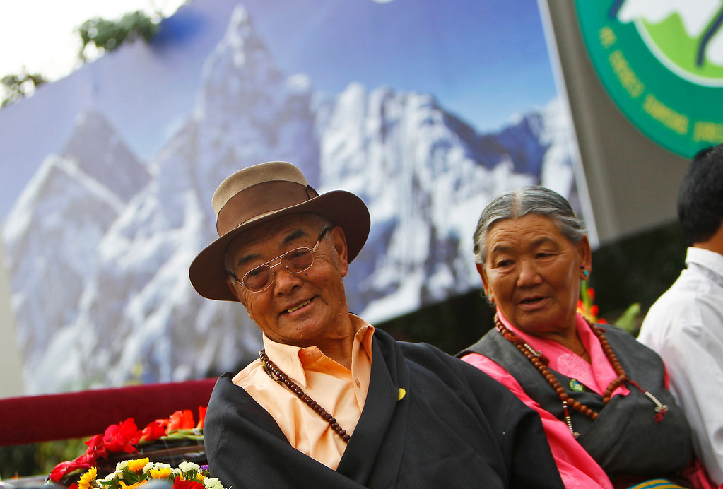 . Kancha Sherpa, left, the only survivor of the first successful expedition to Mount Everest participates in a function to mark the 60th anniversary of successful ascent of Mount Everest, in Katmandu, Nepal, Wednesday, May 29, 2013. Edmund Hillary and Tenzing Norgay were the first people to set foot on the peak of Mount Everest on May 29, 1953. (AP Photo/Niranjan Shrestha)