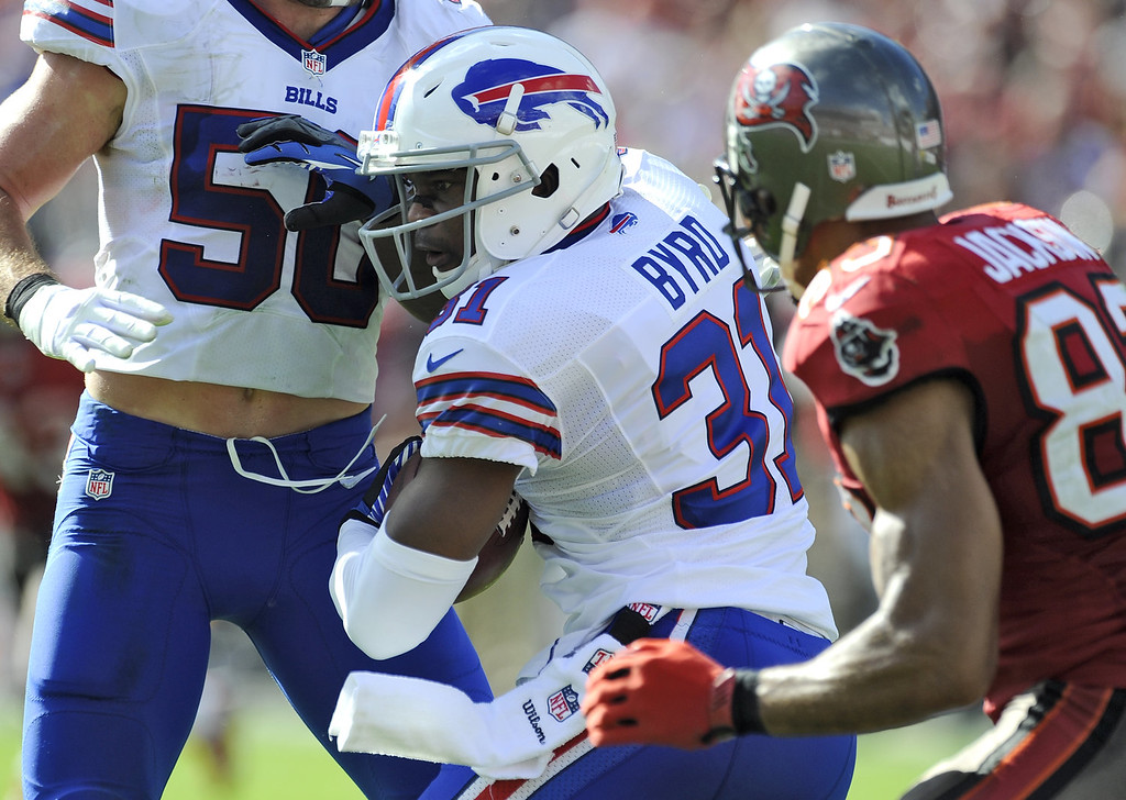 . Buffalo Bills free safety Jairus Byrd (31) runs into teammate Kiko Alonso (50) after intercepting a pass intended for Tampa Bay Buccaneers wide receiver Vincent Jackson (83) during the second quarter of an NFL football game on Sunday, Dec. 8, 2013, in Tampa, Fla. (AP Photo/Brian Blanco)