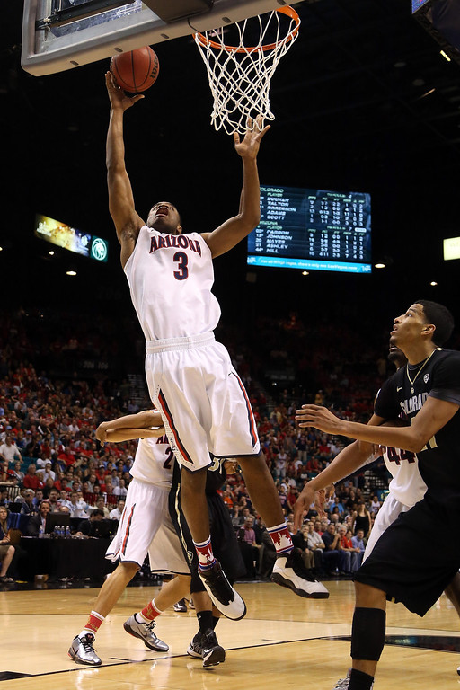 . Kevin Parrom #3 of the Arizona Wildcats lays the ball up against the Colorado Buffaloes during the quarterfinals of the Pac-12 tournament at the MGM Grand Garden Arena on March 14, 2013 in Las Vegas, Nevada.  (Photo by Jeff Gross/Getty Images)