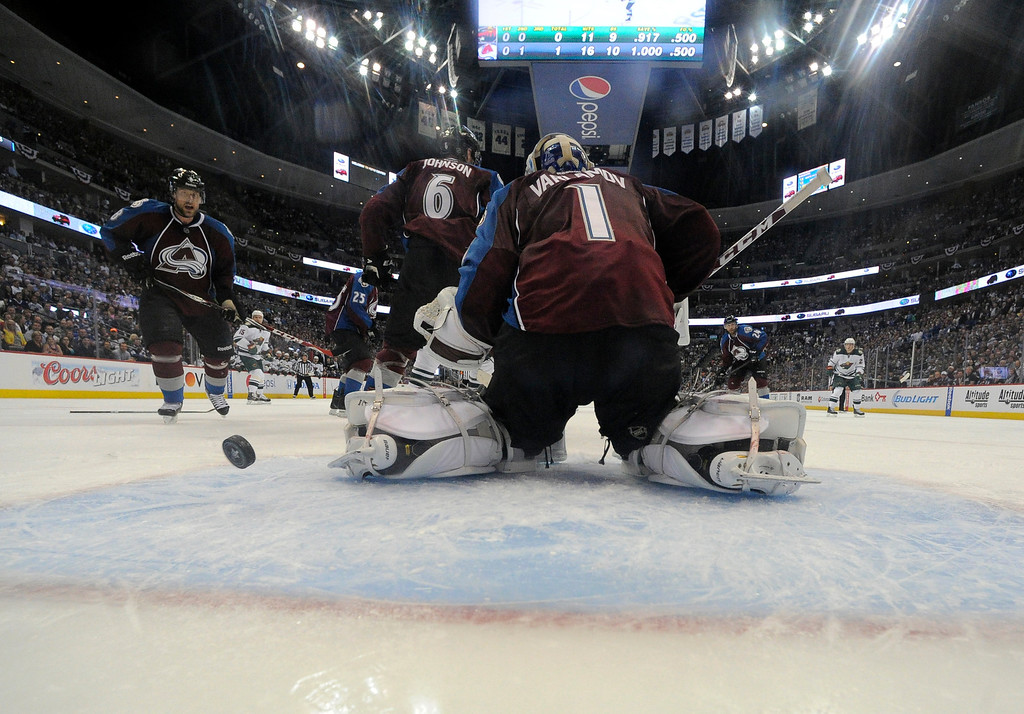. DENVER, CO - APRIL 26: Colorado Avalanche goalie Semyon Varlamov (1) can\'t make a stop on the puck as Minnesota Wild left wing Matt Moulson (26) scores on the play during the second period April 26, 2014 in Game 5 of the Stanley Cup Playoffs at Pepsi Center. (Photo by John Leyba/The Denver Post)