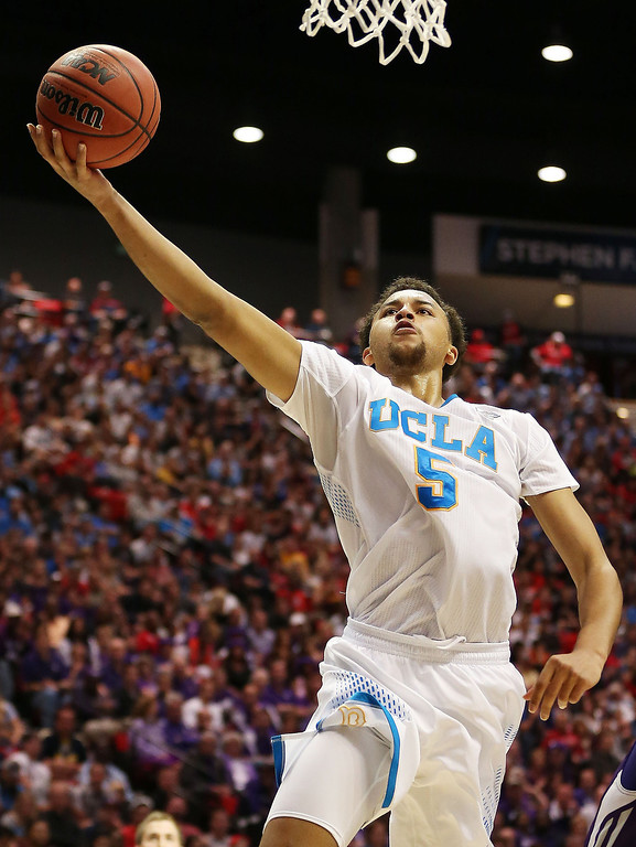 . Kyle Anderson #5 of the UCLA Bruins shoots against the Stephen F. Austin Lumberjacks in the second half during the third round of the 2014 NCAA Men\'s Basketball Tournament at Viejas Arena on March 23, 2014 in San Diego, California.  (Photo by Jeff Gross/Getty Images)