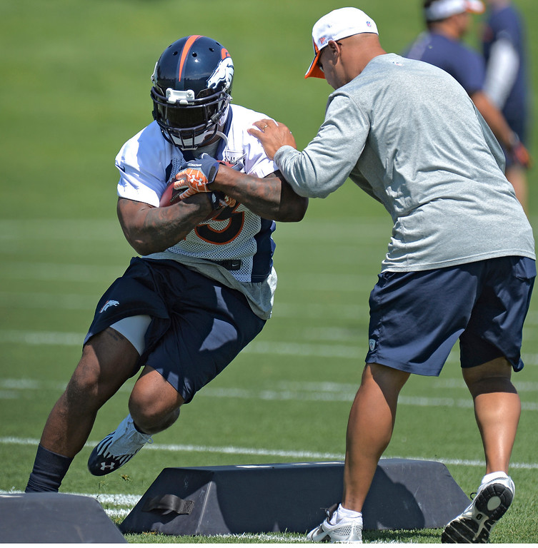 . ENGLEWOOD, CO. - JUNE 11: Running back Willis McGahee (23) of the Denver Broncos runs through drills with Eric Studesville during mini camp June 11, 2013 at Dove Valley. (Photo By John Leyba/The Denver Post)