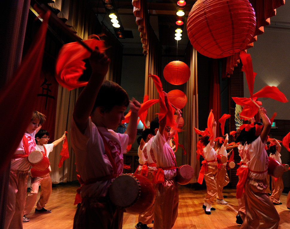 . First-graders perform their Yao Gu Wu dance. Students at the Denver Language School ring in the Year of the Snake with their Chinese New Year celebration performance in the school auditorium. Kindergarteners through 4th grade perform traditional dances dressed in colorful Chinese costumes. According to the school principal, Chinese New Year is the most important of the traditional Chinese holidays. Families make way for  good luck by cleaning their homes symbolizing reconciliation and forgetting old grudges in exchange for peace and happiness. The Chinese New Year (Feb. 10) follows the Chinese 12 Zodiac Calendar Year designating 2013 the Year of the Snake. (Photo By Kathryn Scott Osler/The Denver Post)