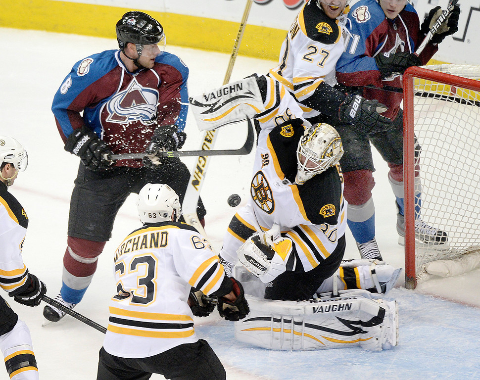 . Boston goalie Chad Johnson (30) made a save in the second period. The Colorado Avalanche hosted the Boston Bruins at the Pepsi Center Friday night, March 21, 2014. (Photo by Karl Gehring/The Denver Post)