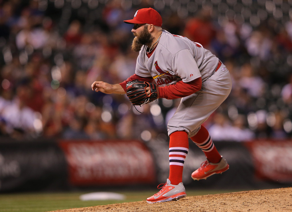 . Relief pitcher Jason Motte #30 of the St. Louis Cardinals delivers to Troy Tulowitzki #2 of the Colorado Rockies in the ninth inning at Coors Field on June 23, 2014 in Denver, Colorado. The Cardinals defeated the Rockies 8-0.  (Photo by Doug Pensinger/Getty Images)