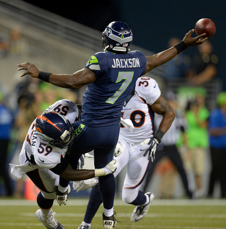 . SEATTLE, WA. - AUGUST 17: Denver Broncos linebacker Danny Trevathan (59) forces Seattle Seahawks quarterback Tarvaris Jackson (7) to throw a pass off balance during the third quarter August 17, 2013 at Century Link Field. (Photo By John Leyba/The Denver Post)