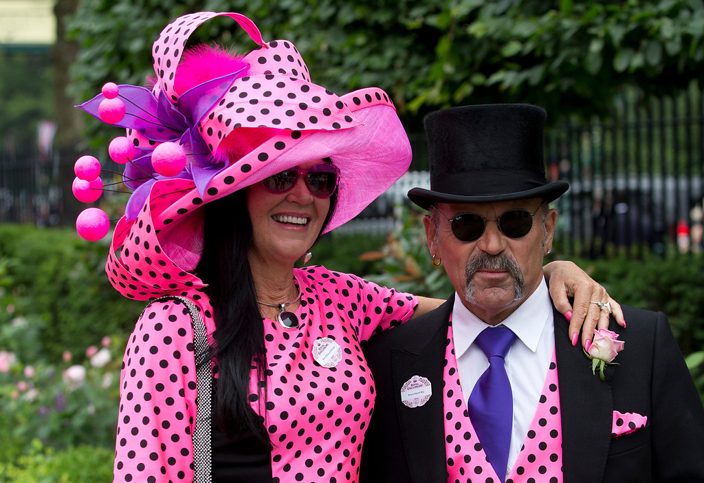 . Brian Mann and Rachel Johnson wear matching black  spots on pink on the third day of the Royal Ascot horse racing meeting, which is traditionally known as Ladies Day, at Ascot, England,  Thursday, June, 19, 2014.  Royal Ascot the annual five day horse race meeting that Britain\'s Queen Elizabeth II attends every day of the event. (AP Photo/Alastair Grant)