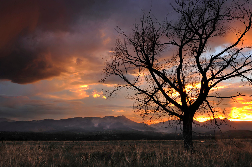 . As the sun sets, the Waldo Canyon Fire continues to grow, Wednesday June 27, 2012, near Colorado Springs. RJ Sangosti, The Denver Post
