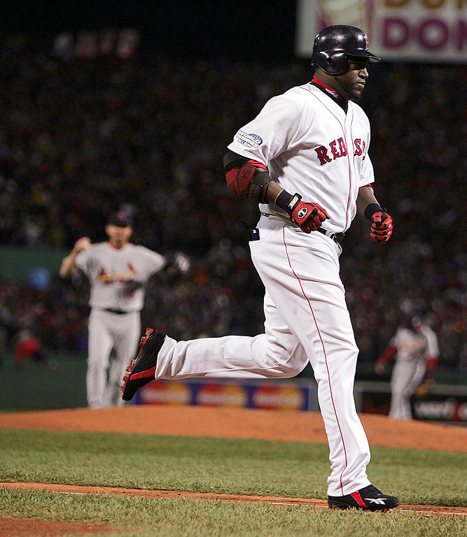 . St. Louis Cardinals pitcher Woody Williams, left, watches as Boston Red Sox\'s David Ortiz rounds the bases after his three-run shot in the first inning of Game 1 of the World Series Saturday, Oct. 23, 2004 in Boston. (AP Photo/Charles Krupa)