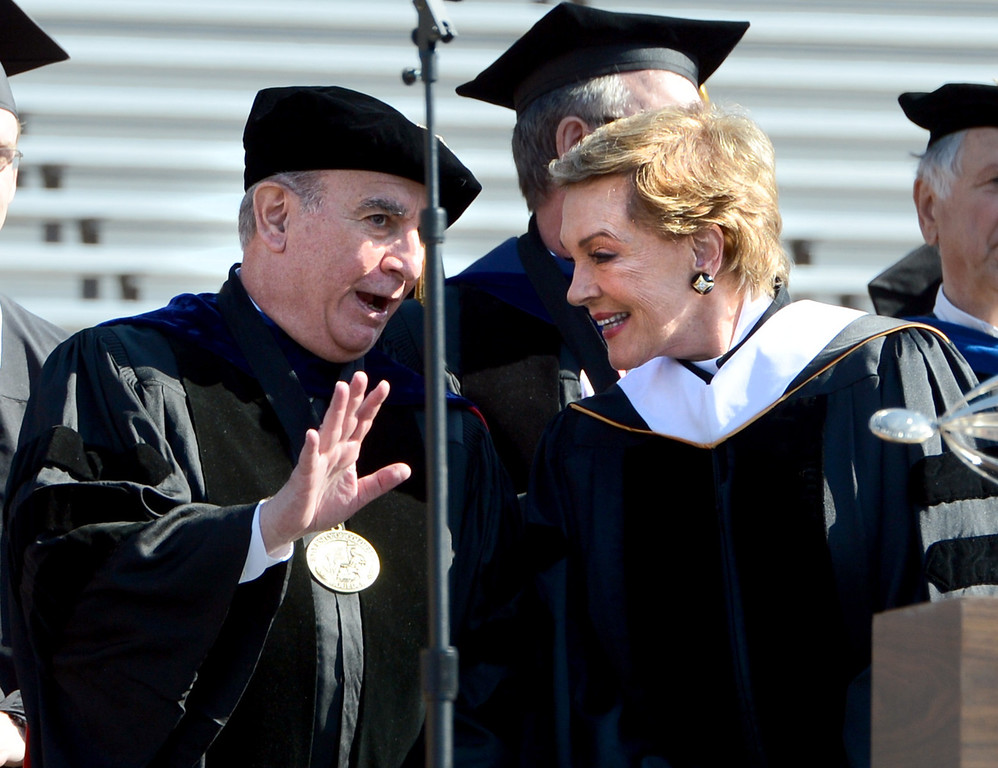 . University of Colorado Chancellor, Phil DiStefano, left, speaks to Julie Andrews before her commencement speech at the University of Colorado-Boulder 2013 Spring Commencement at Folsom Field, in Boulder, Colo., on Friday, May 10, 2013. (AP Photo/Daily Camera, Cliff Grassmick)