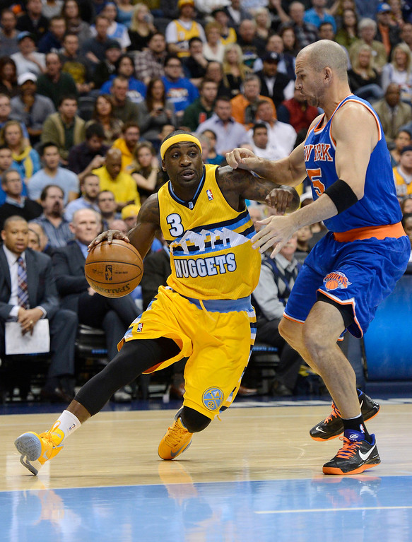 . Ty Lawson (3) of the Denver Nuggets drives on Jason Kidd (5) of the New York Knicks during the first quarter March 13,  2013 at Pepsi Center. (Photo By John Leyba/The Denver Post)
