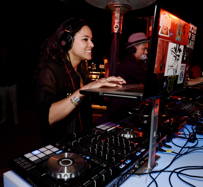 """. Actress Michelle Rodriguez DJ\'s at the after party for the premiere of Universal Pictures\' \""""Fast & Furious 6\"""" at the Gibson Amphitheatre on May 21, 2013 in Universal City, California.  (Photo by Kevin Winter/Getty Images)"""