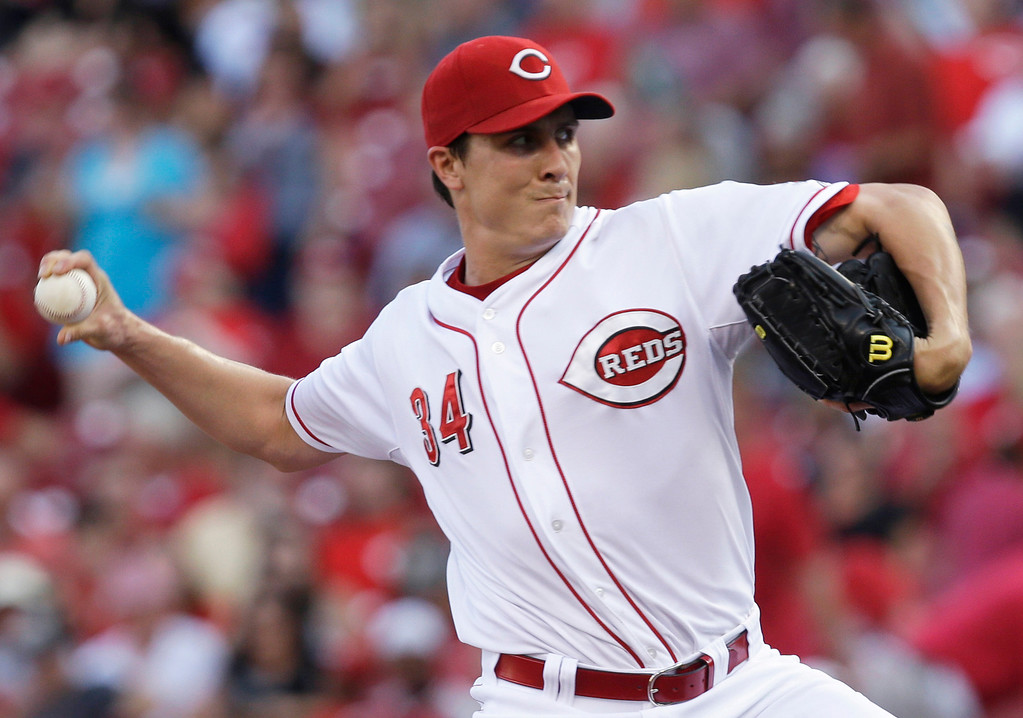 . Cincinnati Reds starting pitcher Homer Bailey throws to a San Francisco Giants batter in the first inning of a baseball game, Tuesday, July 2, 2013, in Cincinnati. (AP Photo/Al Behrman)