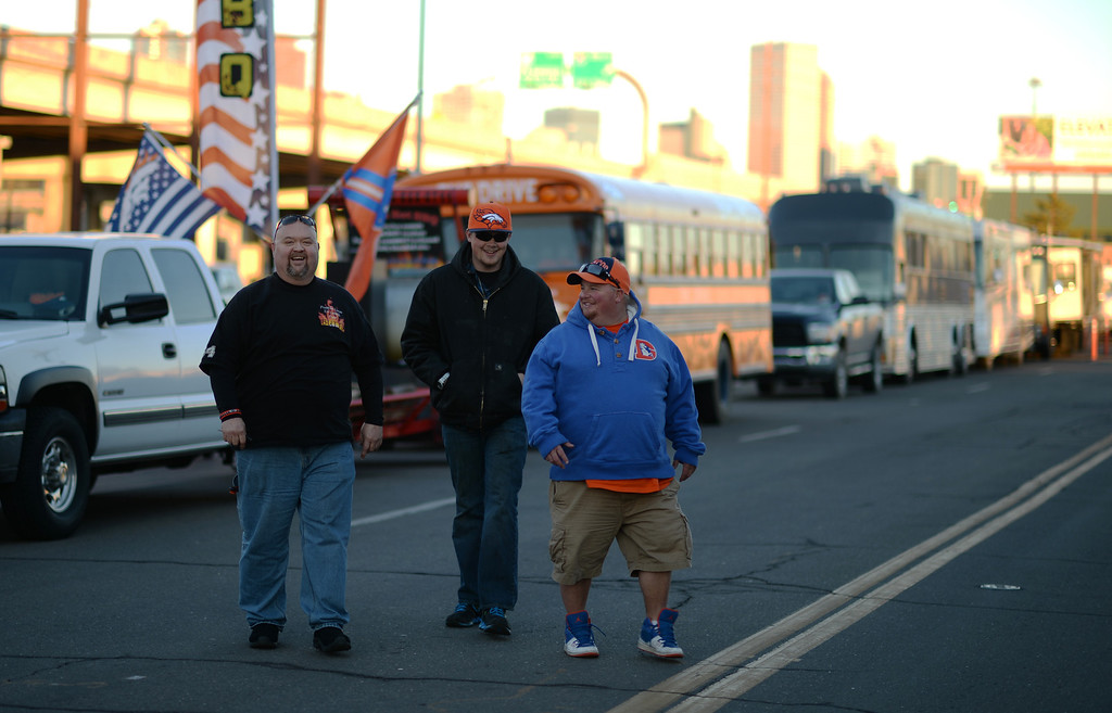 . DENVER, CO. JANUARY 18: From left, Rob Wynne, Ryan Swanson and Kevin Campbell are tailgating the the south side of Sports Authority Field at Mile High Denver. Colorado. January 18. 2014. (Photo by Hyoung Chang/The Denver Post)