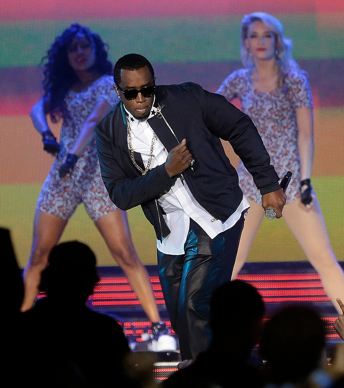 . Rapper P Diddy performs during the NBA All Star basketball game, Sunday, Feb. 16, 2014, in New Orleans. (AP Photo/Gerald Herbert)