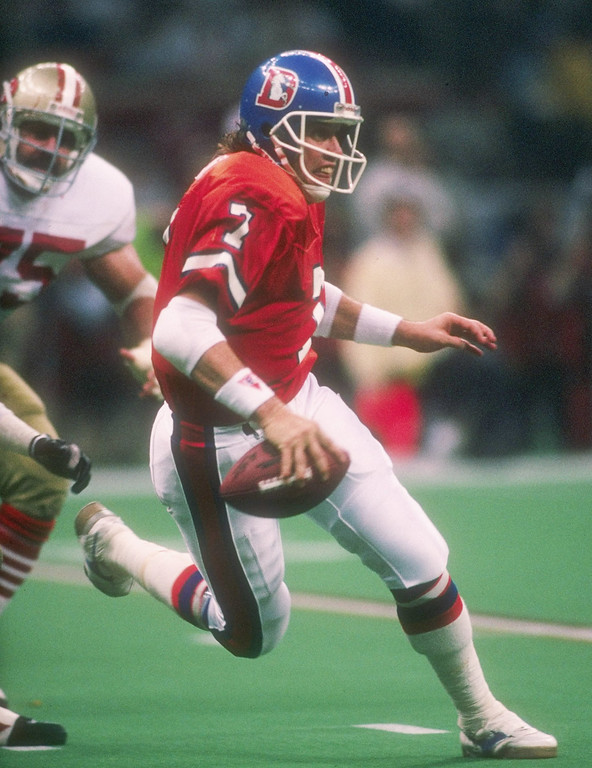 . Quarterback John Elway #7 of the Denver Broncos runs the field looking for an opening during the Super Bowl XXIV game with the San Francisco 49ers at the Louisiana Superdome in New Orleans, Louisiana. The 49ers won the game 55-10. (Rick Stewart/Allsport)