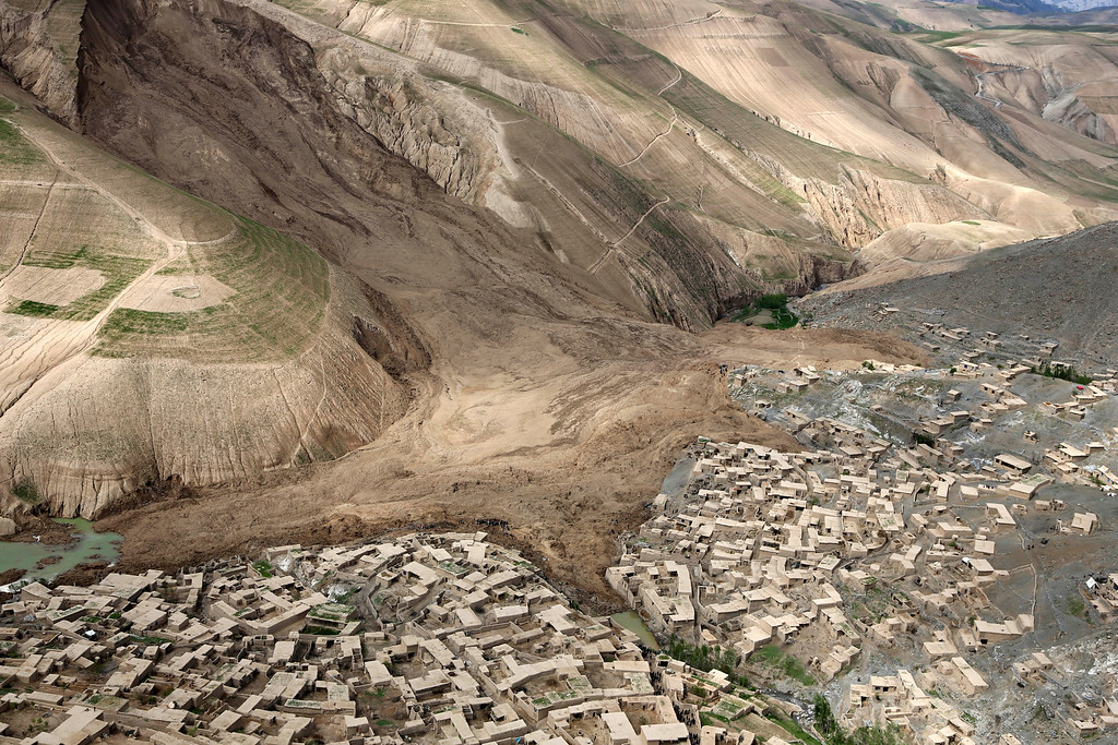 . An aerial view shows the site of Friday\'s landslide that buried Abi Barik village in Badakhshan province, northeastern Afghanistan, Monday, May 5, 2014. Hundreds of people were killed in a horrific landslide and authorities are trying to help the 700 families displaced by the torrent of mud that swept through their village. The families left their homes due to the threat of more landslides, Minister for Rural Rehabilitation Wais Ahmad Barmak said. (AP Photo/Rahmat Gul)