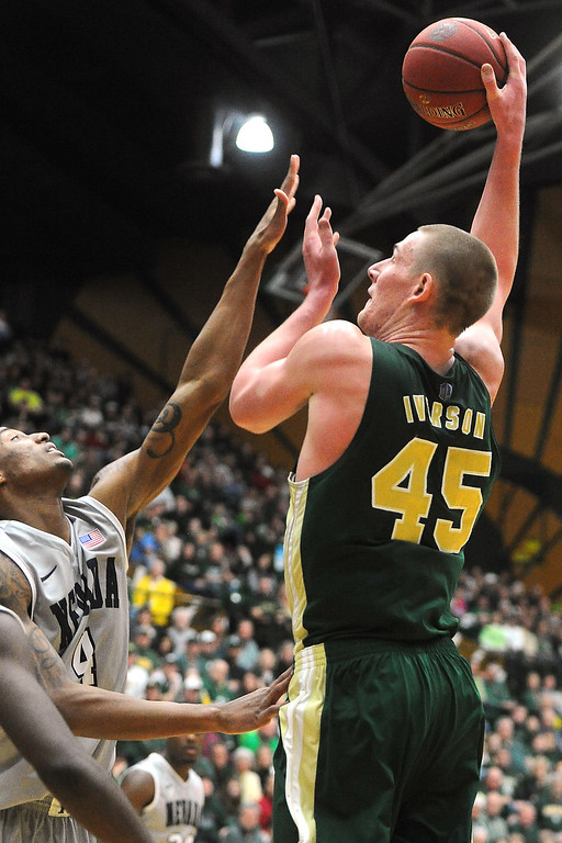 . Colorado State University senior Colton Iverson, right, puts up a shot over Nevada\'s Devonte Elliott in the second half of their game on Saturday, March 9, 2013 at Moby Arena. Steve Stoner, Loveland Reporter-Herald